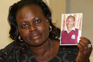 Mrs Sally Chepngetich Bett with a picture of her daughter Emily who died of meningitis. She was a student at Our Lady of Mercy Secondary School in Nairobi. Photo / Daily Nation