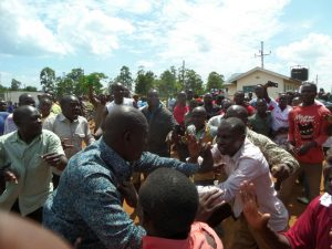 Mayoni MCA Libinus Oduor is attacked by Mumias East MP Benjamin Washiali's supporters during a chaotic rally at Shibale Shopping Centre, November 25, 2016.