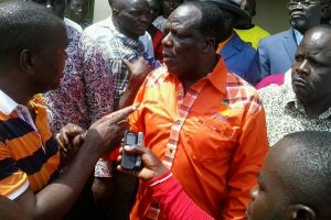 Youths confront Kakamega Governor Wycliffe Oparanya at Shibale in Mumias on November 25, 2016.