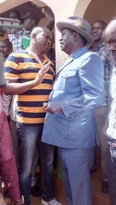 Cord leader Raila Odinga with former ODM national youth leader Rashid Mohammed during a chaotic rally at Shibale Shopping Centre, November 25, 2016.